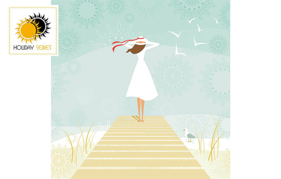 Woman in sunhat and white dress, standing at end of boardwalk looking out to sea, gulls flying