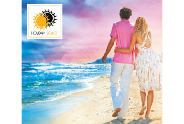 Young couple walking on beach at sunset, heightened colours