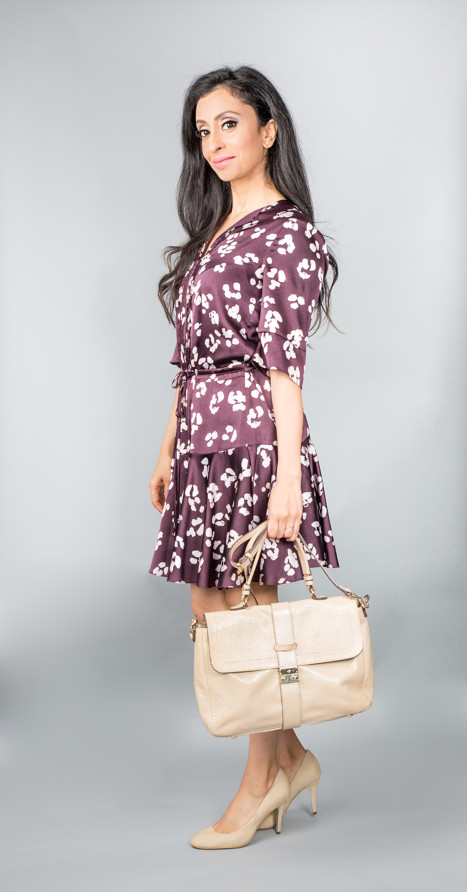 Nadia with handbag with multi-purpose strap