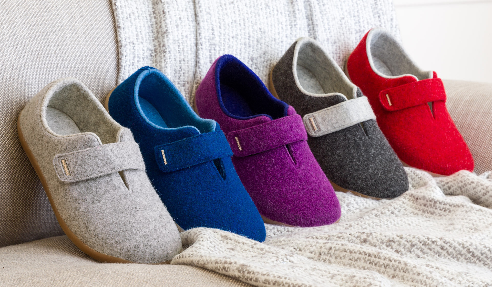 5 brightly coloured shoes in a row