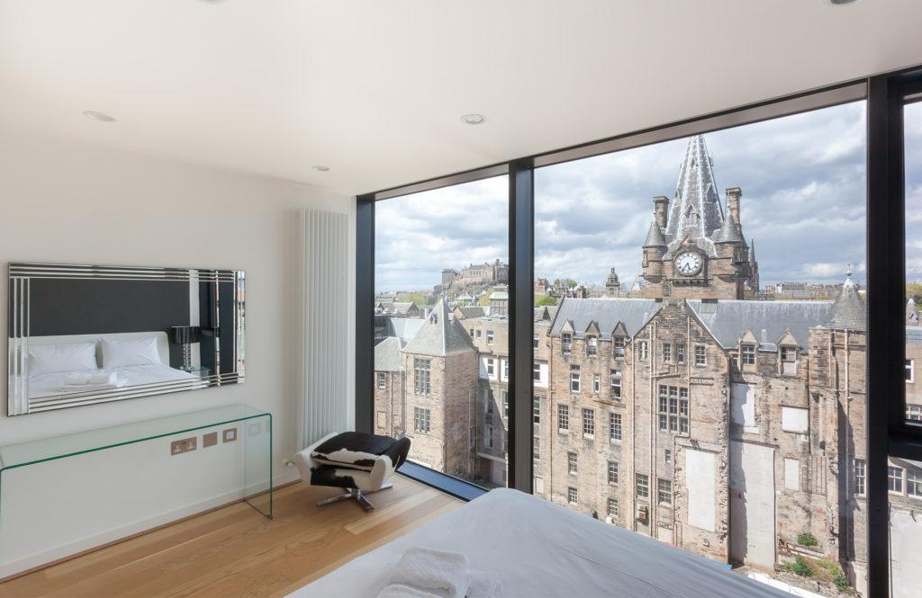 Edinburgh Old Town buildings seen through window of modern apartment