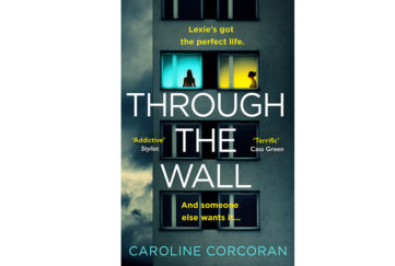 Cover of Through The Wall by Caroline Corcoran. Two women each silhouetted in lit windows of a tower block