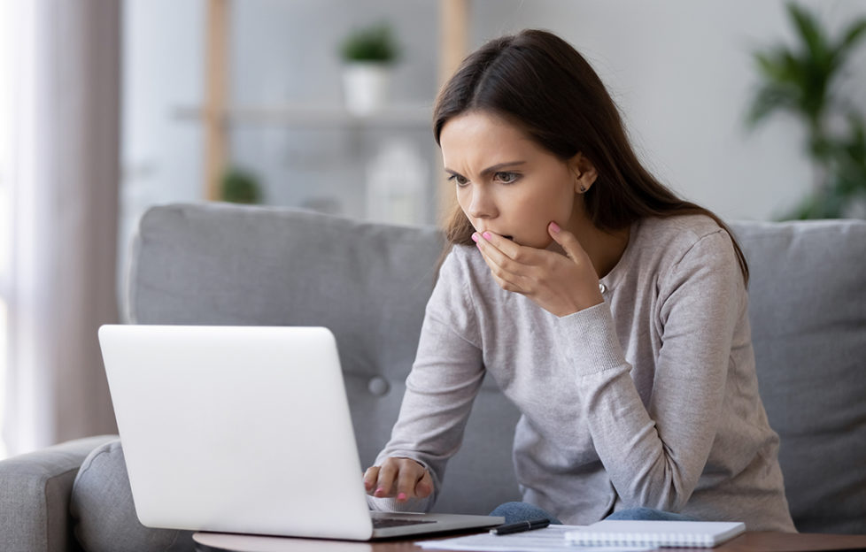 A lady worried after accessing bank details online Pic: Istockphoto