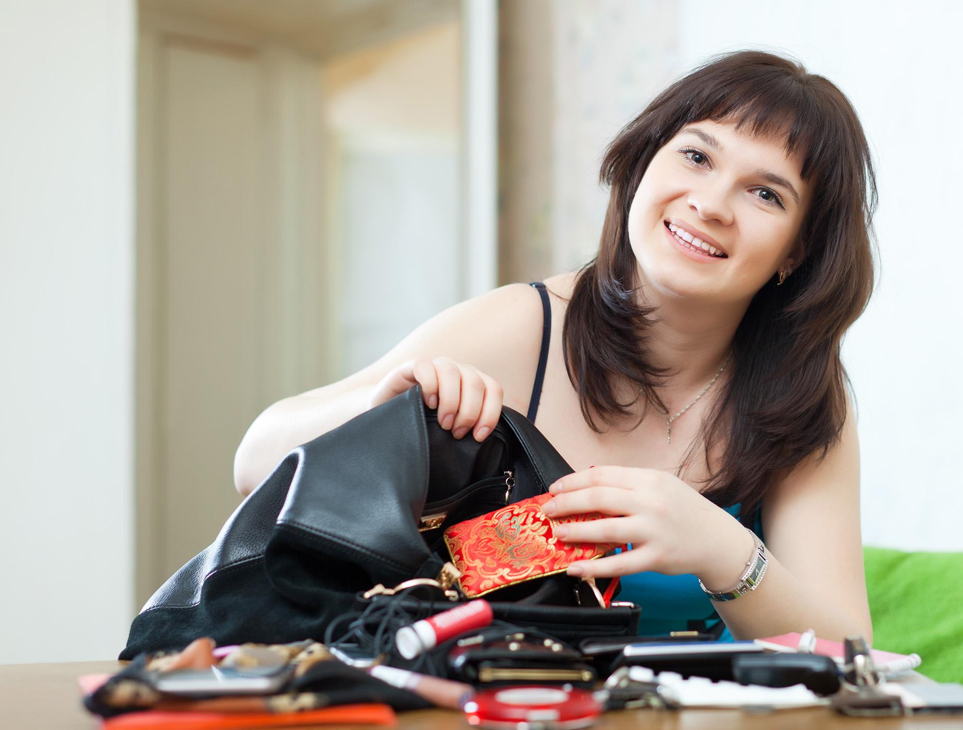 Woman unpacking large handbag