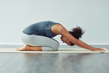 Woman in child's pose at yoga