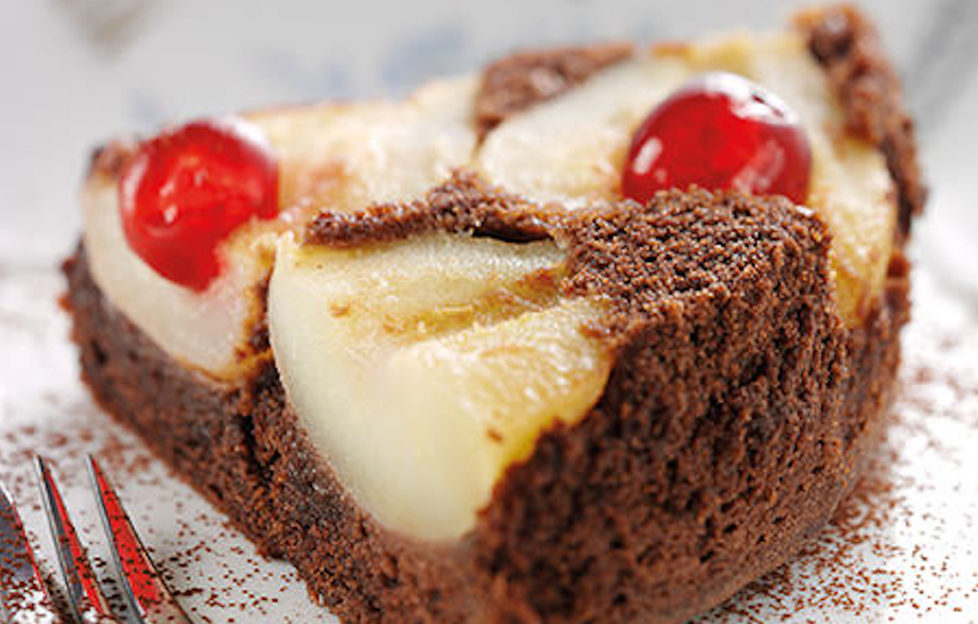 Chocolate and pear upside-down cake with glace cherries