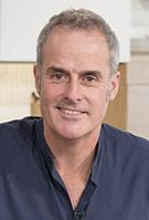 Portrait shot of celebrity chef Phil Vickery in dark blue shirt