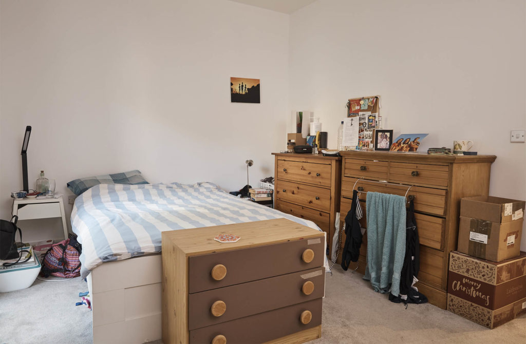 Cluttered room with 3 mismatched sets of drawers