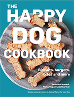 Cover of happy dog cookbook, plate of bone shaped biscuits on turquoise background