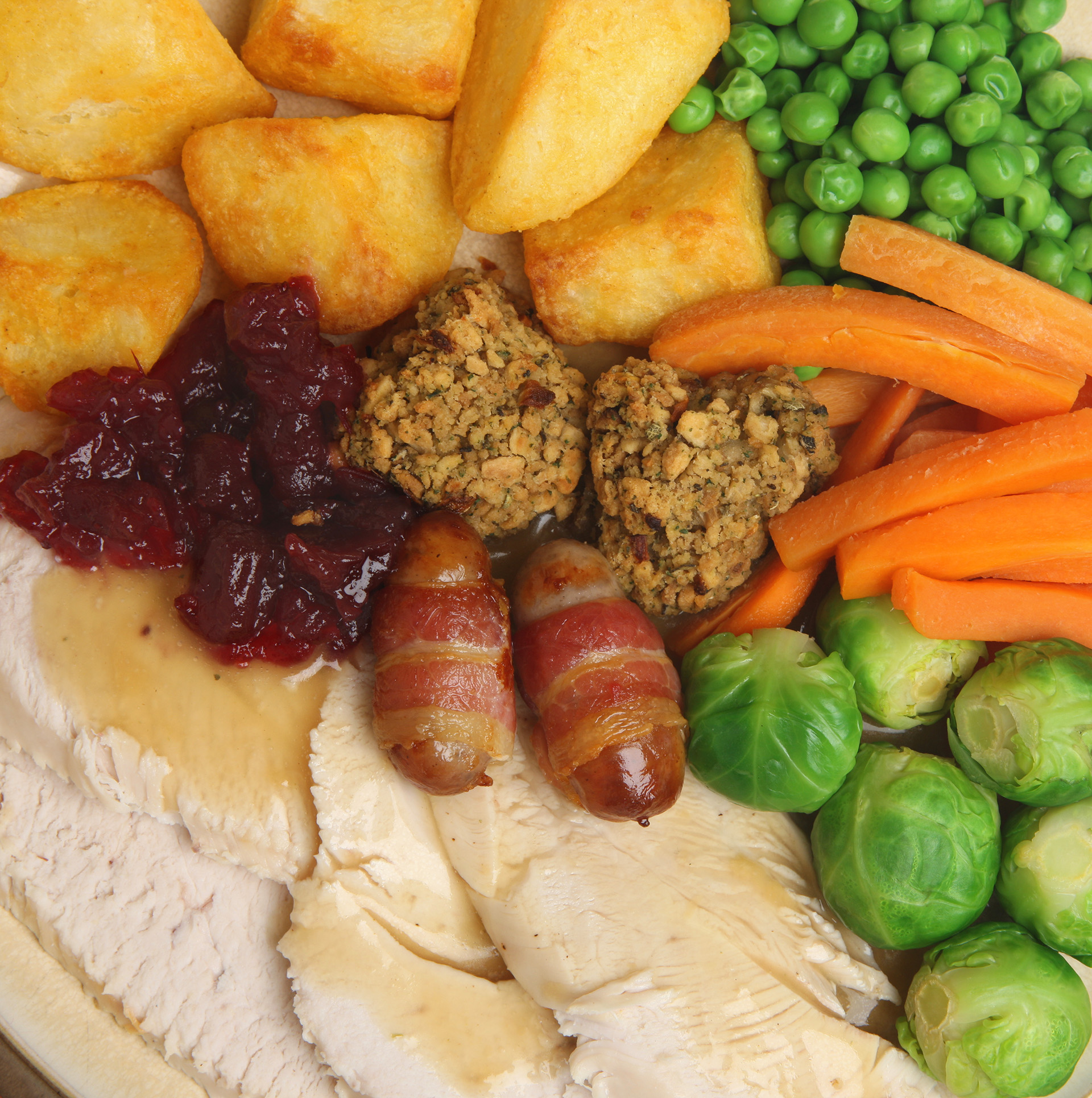 Christmas roast turkey dinner with traditional trimmings.