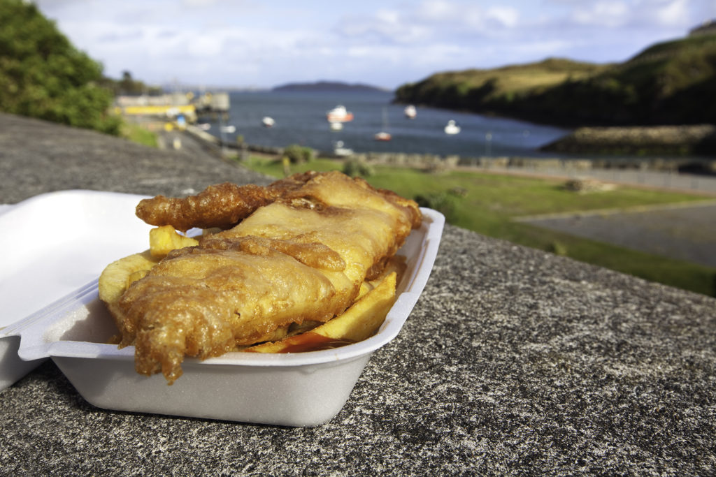 Fish and chips are ready to eat outdoors