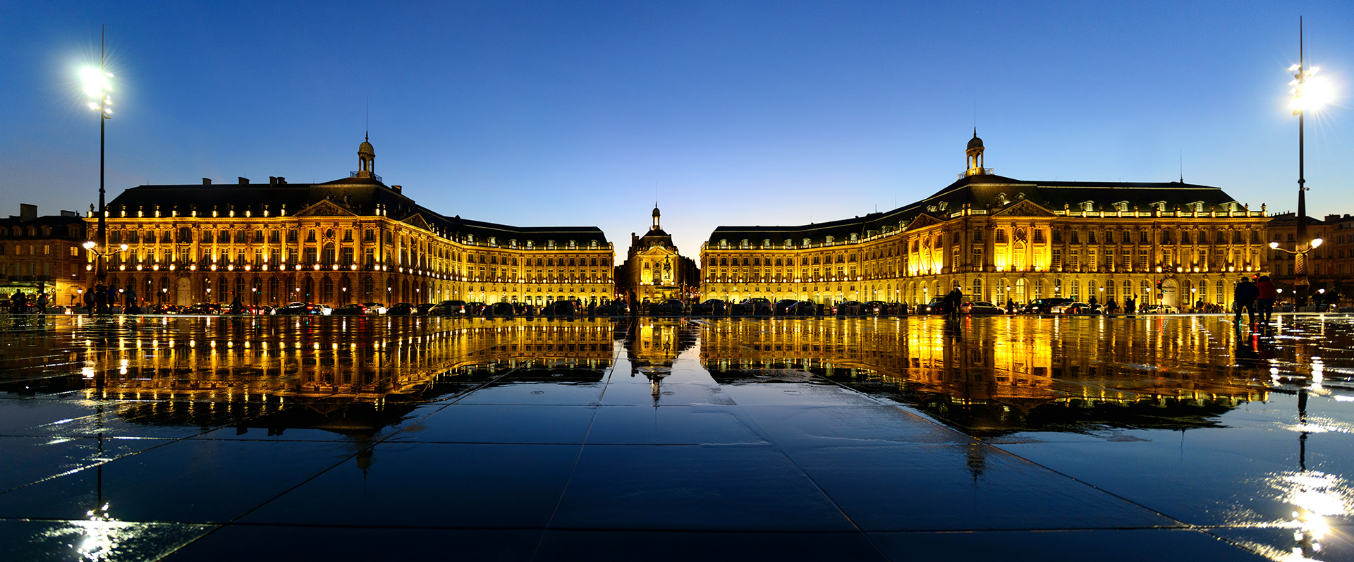 The Water Mirror point and the famous Place Royale of Bordeaux, France. Panorama of Bordeaux's UNESCO World Heritage-listed waterfront at dusk.