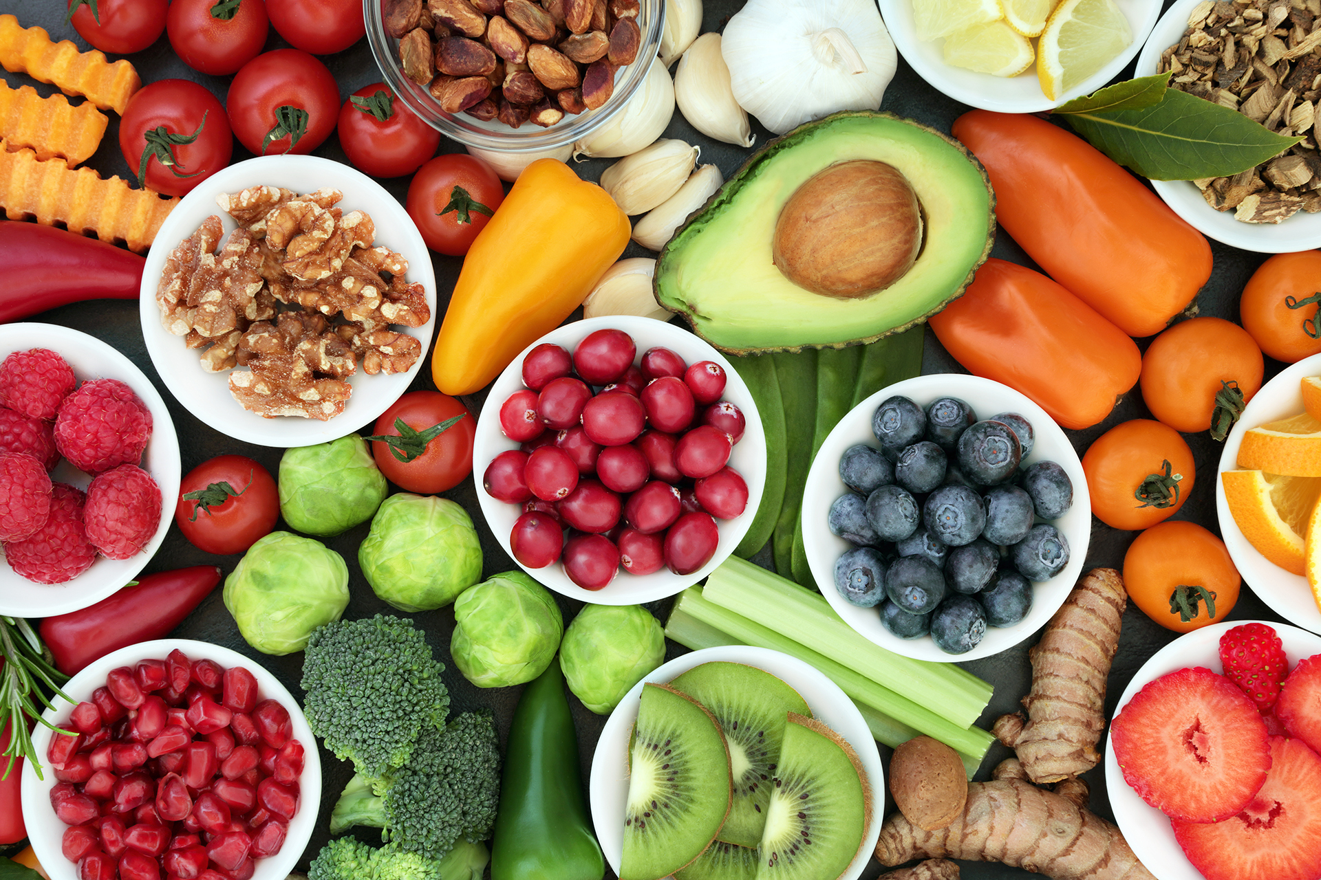 Healthy superfood concept with vegetables, fruit, herbs, spice and nuts. Food very high in antioxidants, anthocyanins, omega 3, minerals and vitamins.