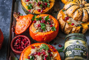 4 mini pumpkins of different colours, tops sliced off, filled with grain mix, cranberries and pomegranate seeds, scattered with fresh herbs, jar of Meridian pumpkin seed butter on the side