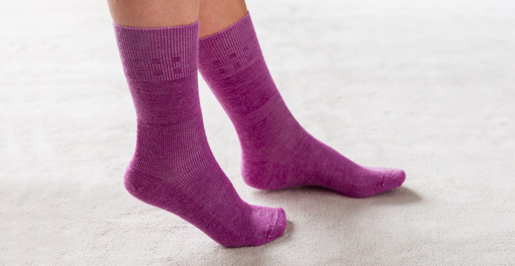 Pair of purple socks on feet