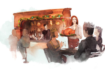 Middledip mini serial. Smiling man and woman serving people food in a pub on Christmas day