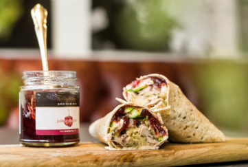 Wrap using up Christmas leftovers - turkey, cranberry, stuffing and sprouts with jar of Hot Cranberry sauce