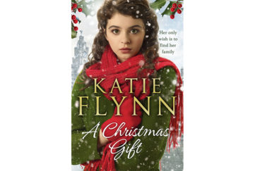 Cover of A Christmas Gift. Photo of teenage girl in coat and scarf, with wide anxious eyes. It's snowing