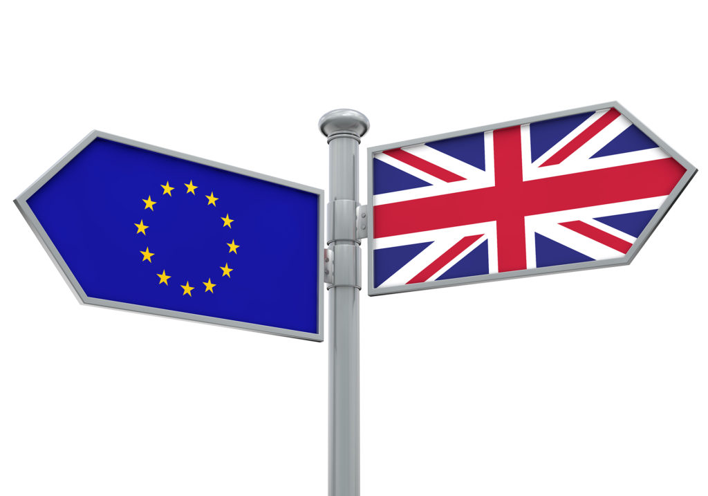 EU and United Kingdom flags on a signpost, pointing in opposite directions