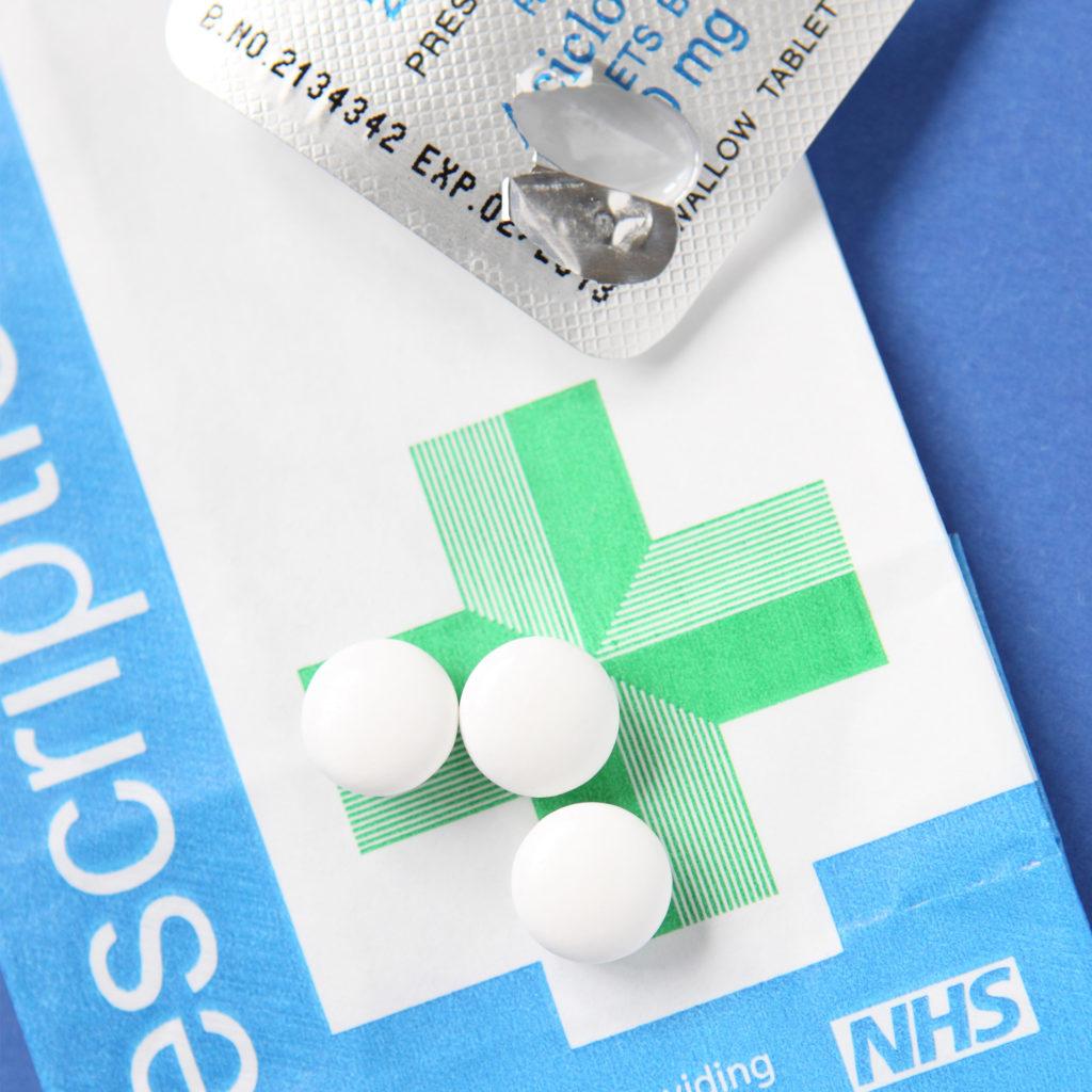 pills, foil and prescription bag