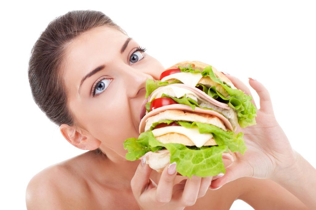 Woman with huge sandwich