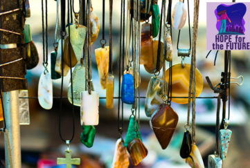 Semi precious stone pendants hanging on a craft stall