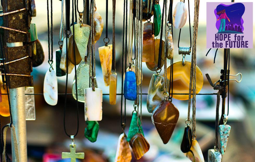 Semi precious stone pendants hanging on a craft stall