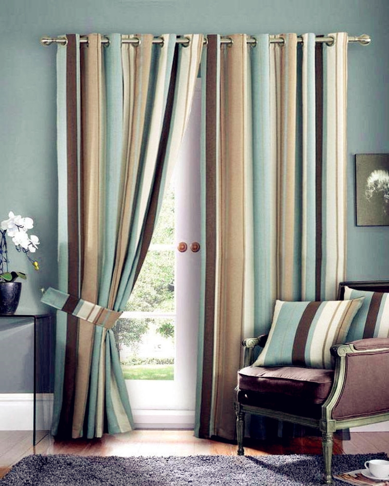Bold green, gold and brown vertical striped eyelet topped curtains on a pole