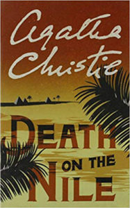 Cover of Agatha Christie's Death On The Nile, palm fronds, desert and dark reddish sky