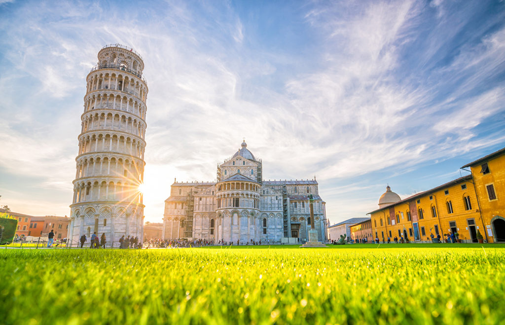 Pisa Cathedral and the Leaning Tower in a sunny day in Pisa, Italy.; Shutterstock