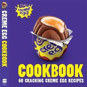 Cover of Cadbury Creme Egg Cookbook, purple background, yellow lettering and large image of creme egg with top bitten off showing liquid centre