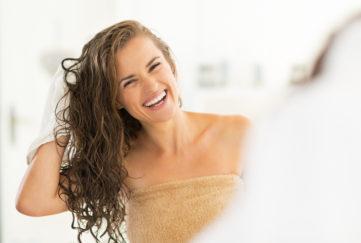 woman washing hair - advice on lockdown hair