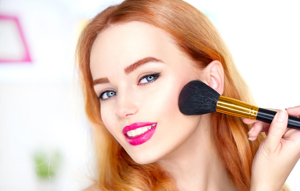 Woman applying blusher Pic: Shutterstock