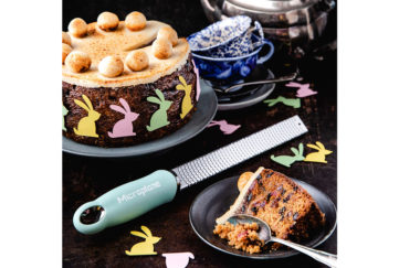 Rich fruit simnel cake topped with toasted marzipan and egg shapes, coloured bunny cut-outs around the sides