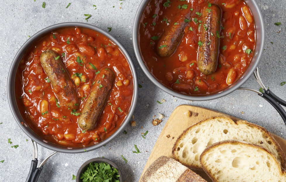 2 bowls of casserole, each with 2 sausages and rich spicy homemade tomato sauce and beans