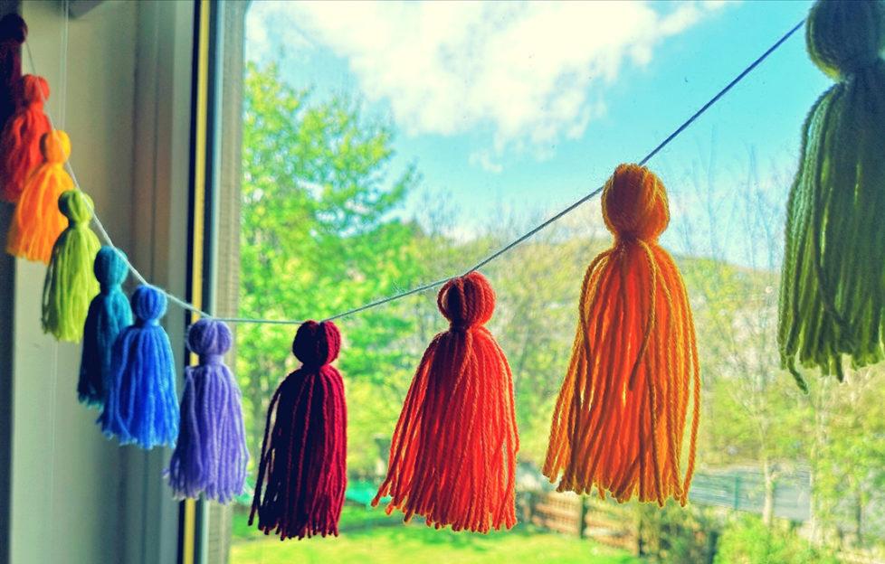 Rainbow garland at the window