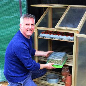 Matt at wooden greenhouse