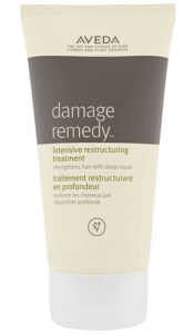Tube of Aveda Damage Remedy, cream with dark brown stripe