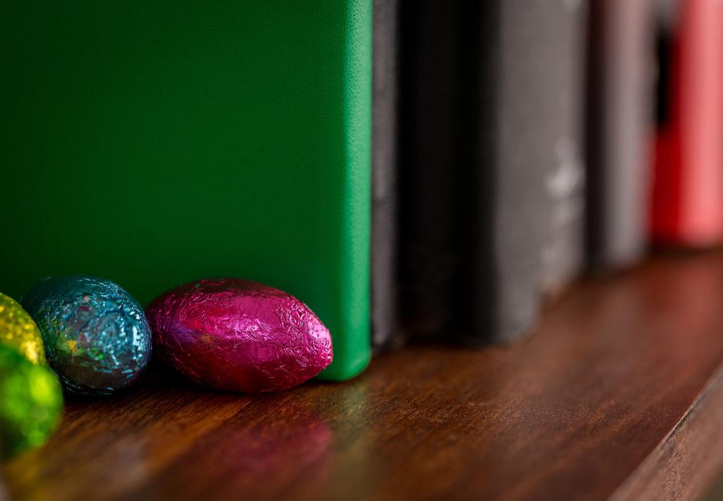 Foil wrapped easter chocolate hidden on bookshelf