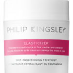 Philip Kingsley Elasticiser hair product, small wide jar with white lid and magenta stripe on label