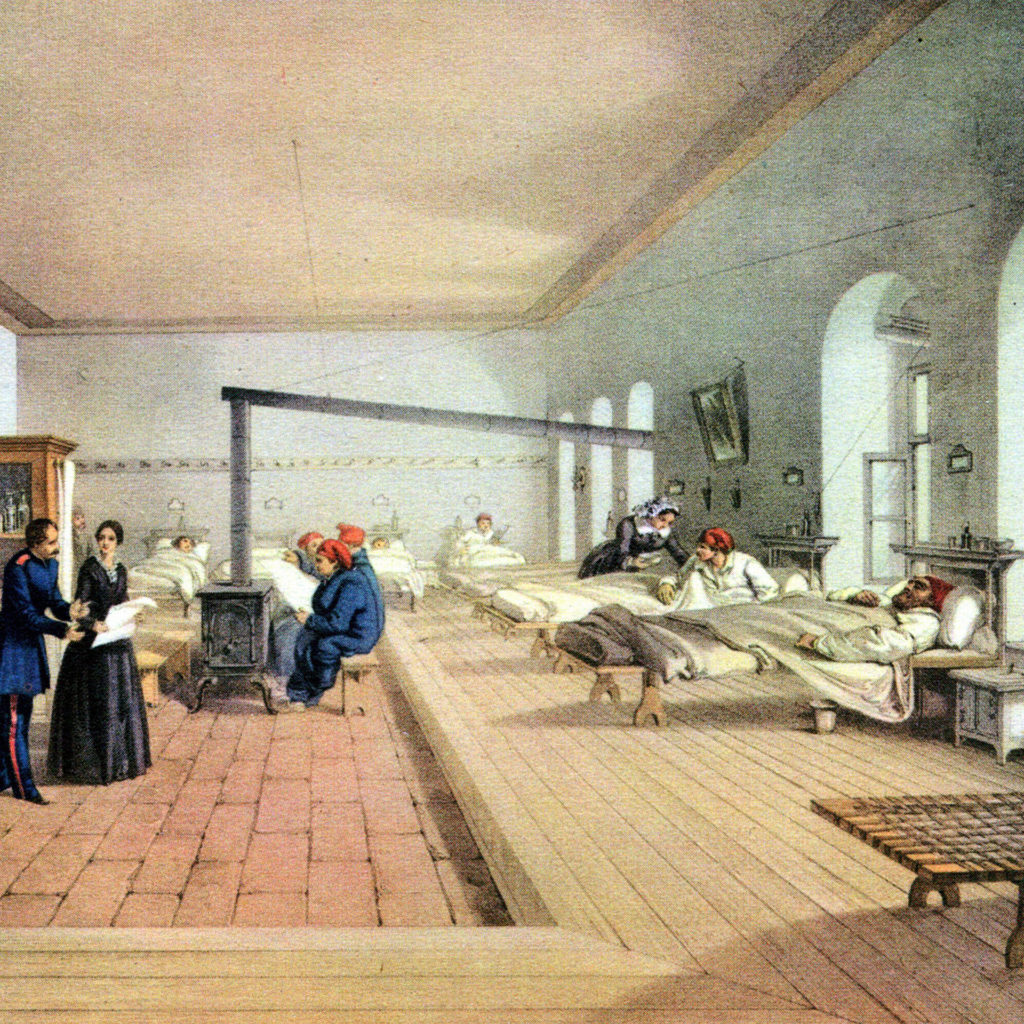 Coloured etching of Florence Nightingale in clean, bright, spacious hospital ward with stove, open windows, well spaced beds and well stocked medicine cabinets.