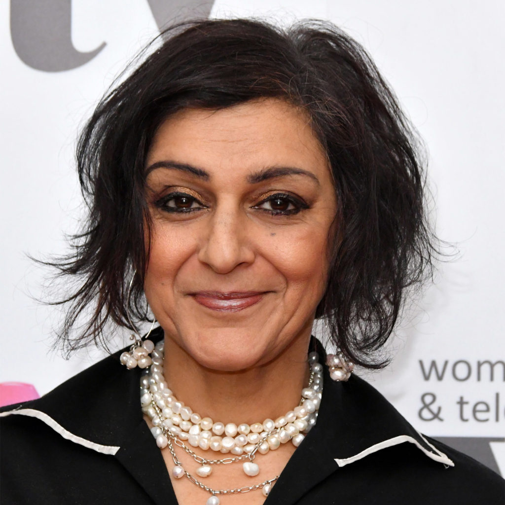 Actor and comedian Meera Syal in glamorous make-up, black dress and pearl jewellery