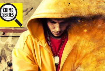 Youth in yellow hoodie, head down