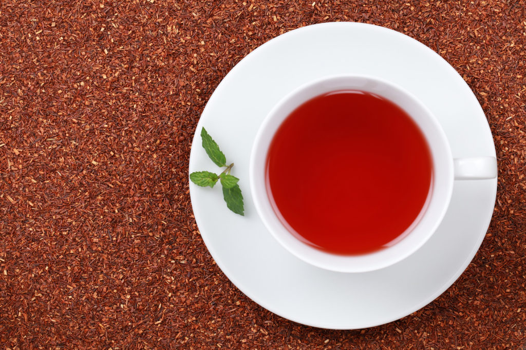 Rooibos Tea in a cup with lots of copy space;