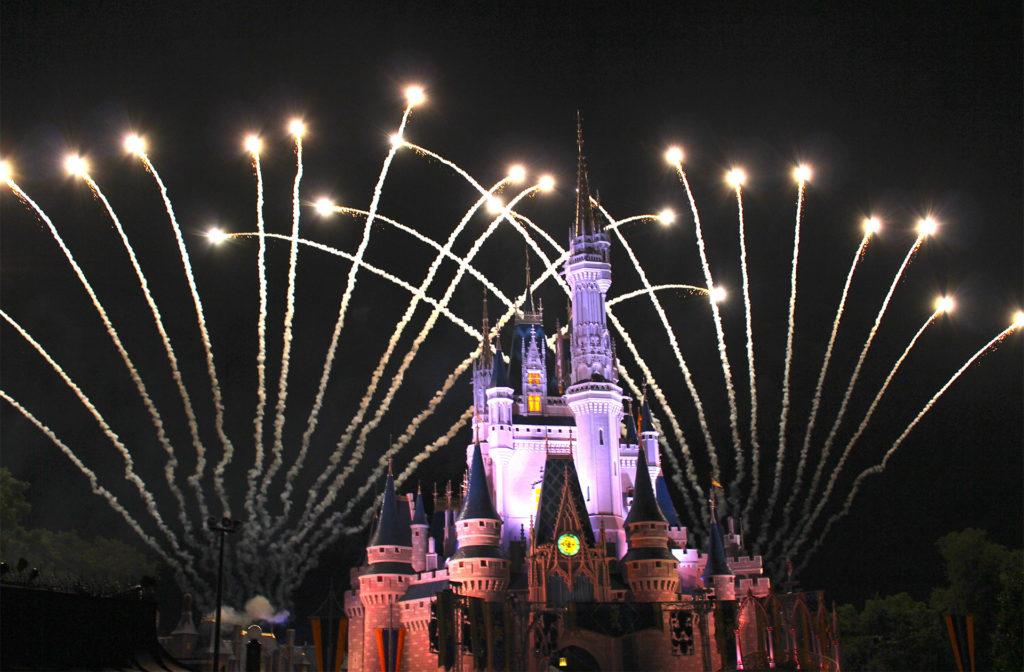 fireworks over Disney castle in Florida, night time
