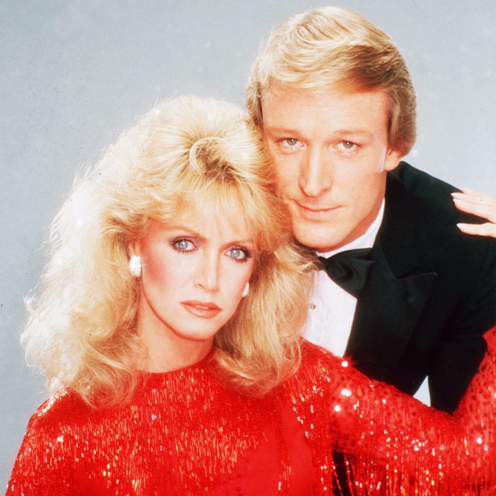 Blond couple in evening dress, soft focusDonna Mills and Ted Shackelford in Knots Landing