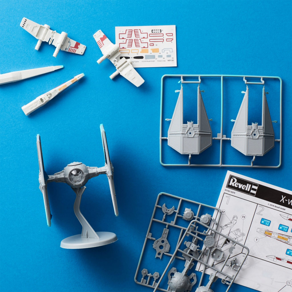 Parts of spaceship model kit and instructions