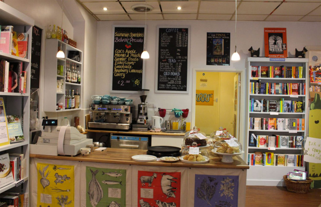 Cafe counter in bookshop, selling smoothies and cakes