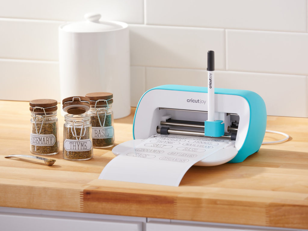 Cricut Joy machine printing out labels for spice jars