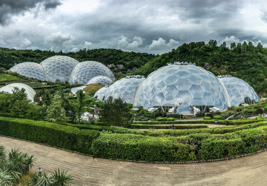 Series of glass domes in countryside, gardens in foreground